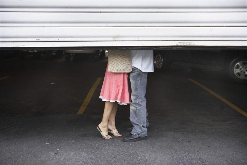 Couple kissing behind garage door