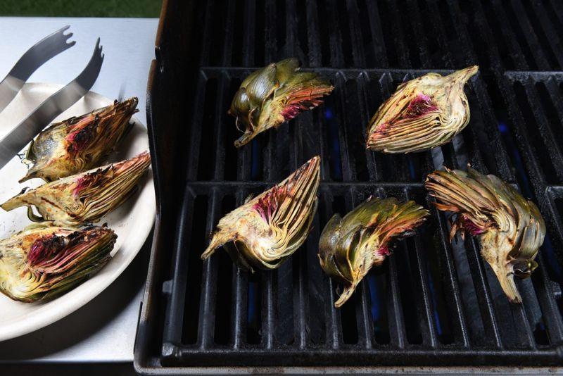 Artichoke halves on a gas grill