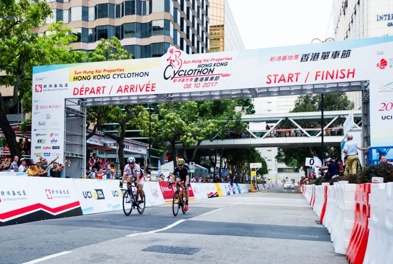 HONG KONG - OCTOBER 08: Yukiya Arashiro (L) of Japan National Team crosses the finish line for third place during the Sun Hung Kai Properties Hong Kong Cyclothon on October 8, 2017 in Hong Kong, Hong Kong. Top cyclists of 17 professional teams from 12 countries and regions compete in the first UCI Asia Tour Class 1.1 Road Race at Hong Kong Cyclothon, staged by the Hong Kong Tourism Board on 8 October, 2017.