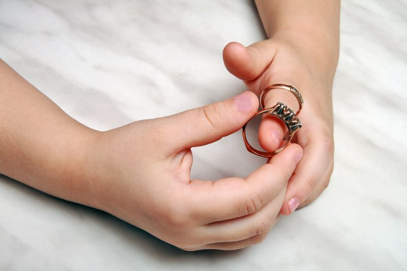 The hands of girls wearing gold rings