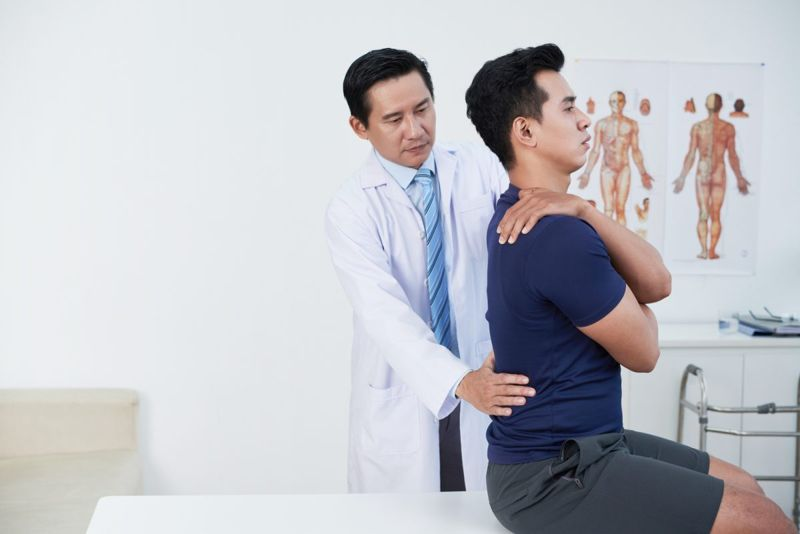 doctor checking posture patient