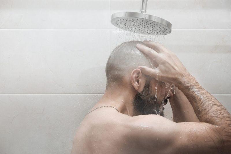 man showering hygiene
