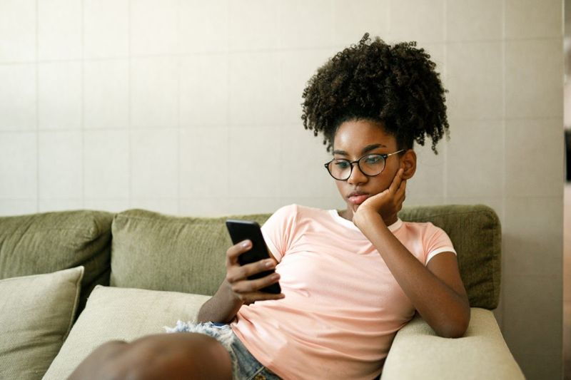 Bored woman looking at phone