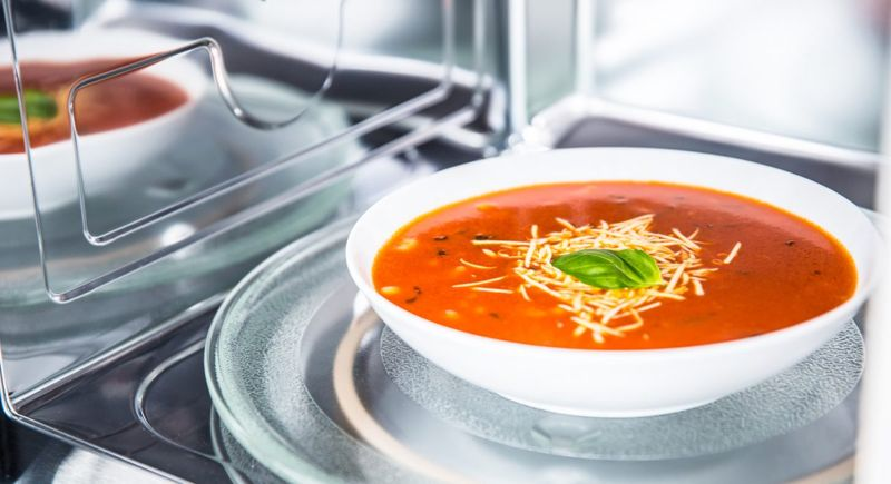 Bowl of soup in microwave