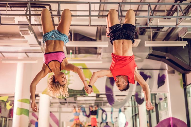 couple hanging upside down