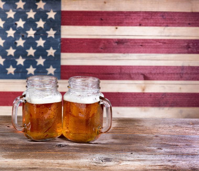 Beers in front of flag