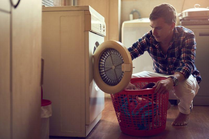 man washing clothes laundry