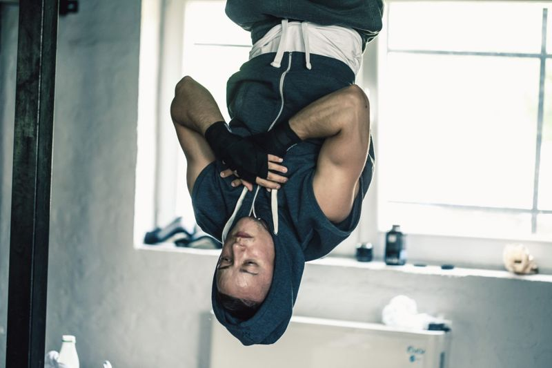 hanging upside down man exercise