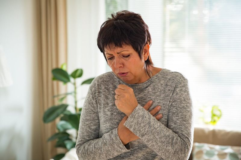 woman coughing wheezing
