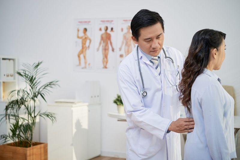 doctor adjusting posture muscles