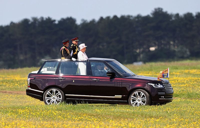 LARK HILL, ENGLAND - MAY 26: Queen Elizabeth II, Captain-General of the Royal Regiment of Artillery, oversees a Royal Review from an open-top Range Rover on the occasion of their Tercentenary at Knighton Down on May 26, 2016 in Lark Hill, England. Queen Eliabeth II has been Captain-General of the Royal Regiment of Artillery since 6 February 1952.