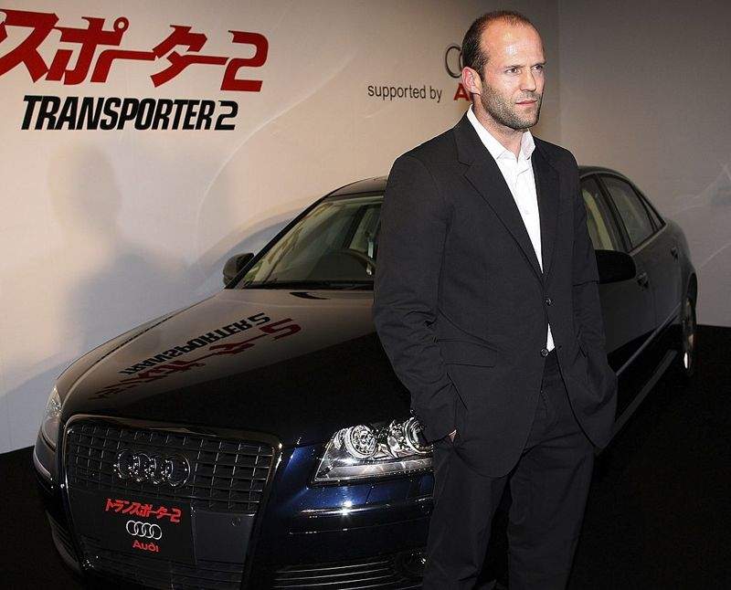 """TOKYO, JAPAN - MAY 16: Actor Jason Statham poses in front of a car during a press conference promoting """"Transporter 2"""" on May 16, 2006 in Tokyo, Japan. The film will open on June 3 in Japan."""
