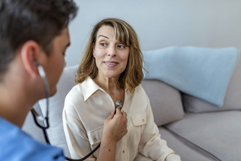 woman heart stethoscope