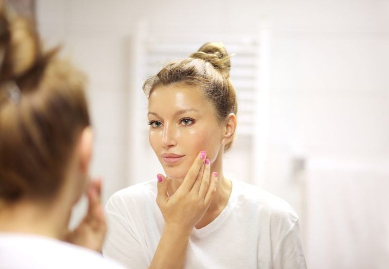 woman mirror topical application
