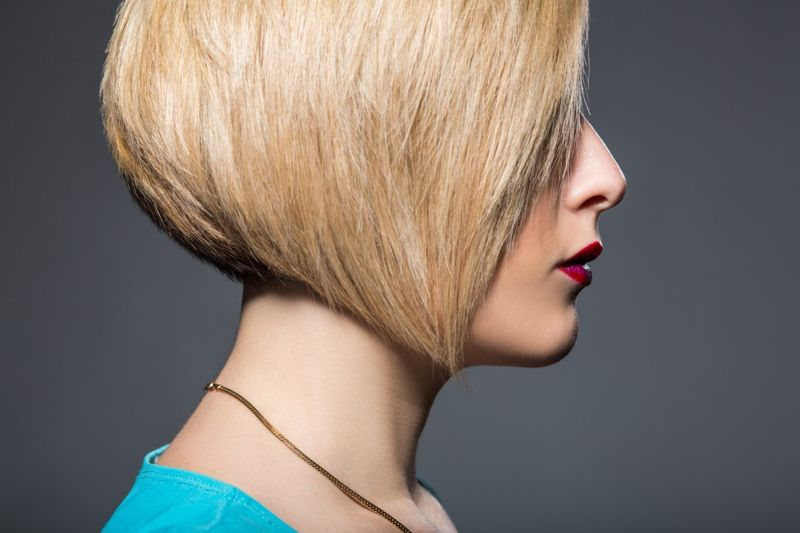 Young woman with short trendy haircut and bright makeup