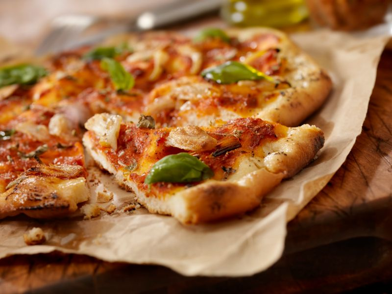Authentic Italian, Hand Made Marinara Pizza with Roasted Garlic, Marinara Sauce, Fresh Basil and Olive Oil