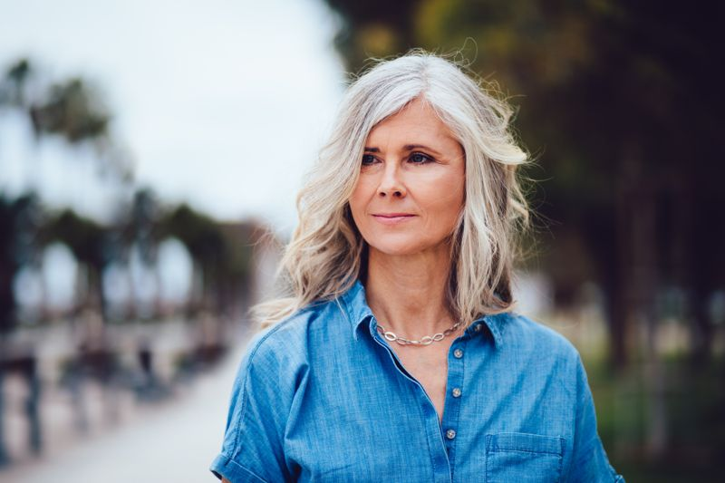 Portrait of beautiful senior woman with grey hair outdoors