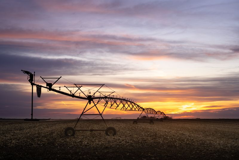 Farm equipment on a Nebraska sunset