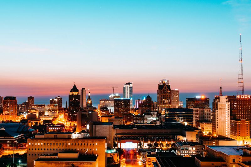 Downtown Milwaukee at sunrise with Lake Michigan in the background.