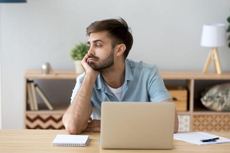 man at computer, uncaring