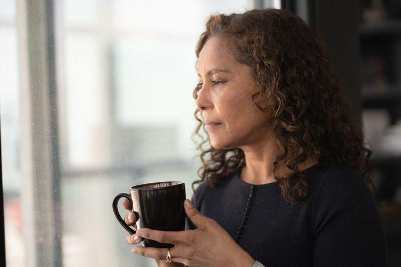 woman contemplative staring