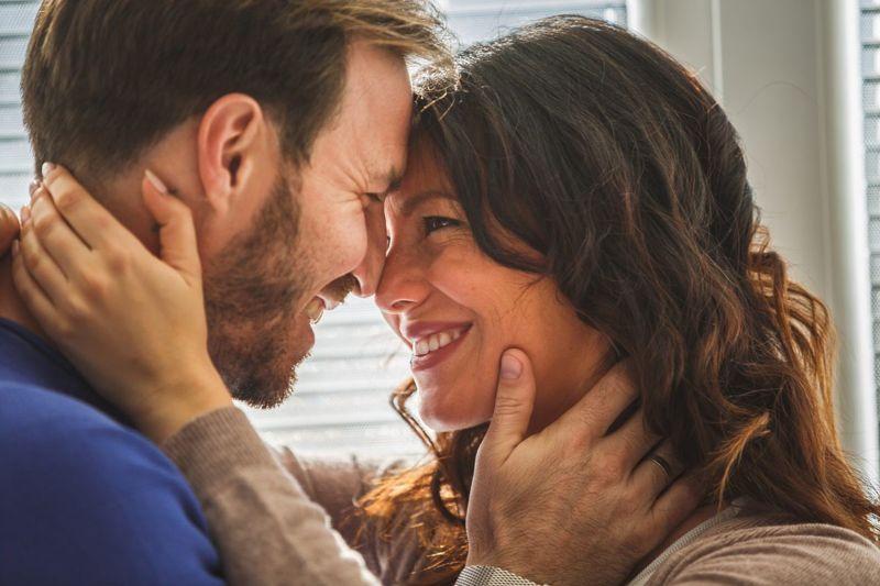 Affectionate couple gazing into eyes