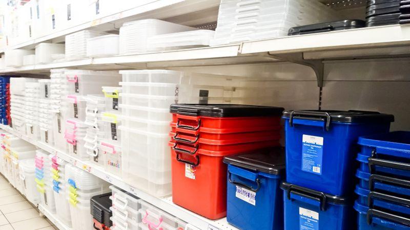 Assorted brand of plastic storage box on shelf rack display i