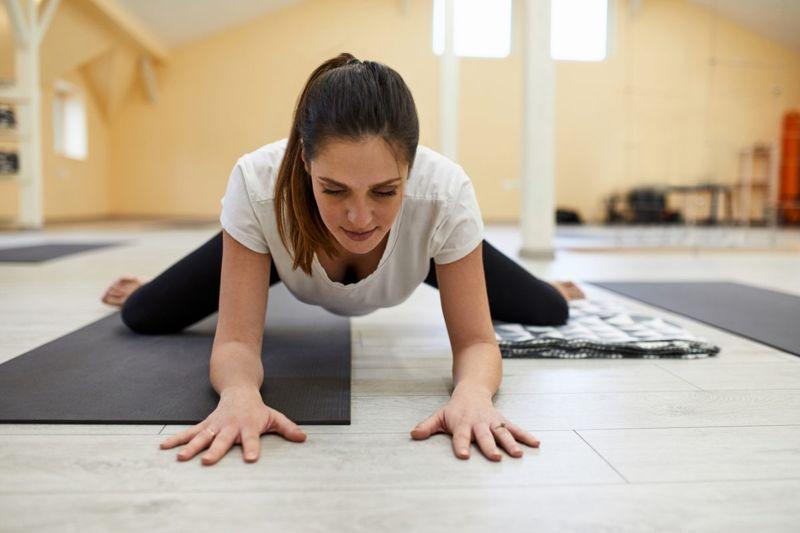 woman yoga frog pose