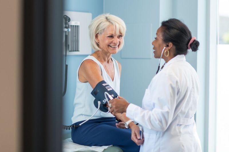 doctor checks ladies blood pressure