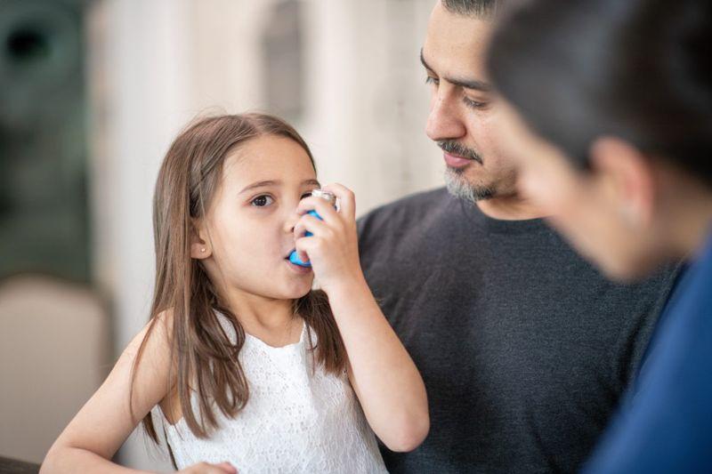 child with an inhaler
