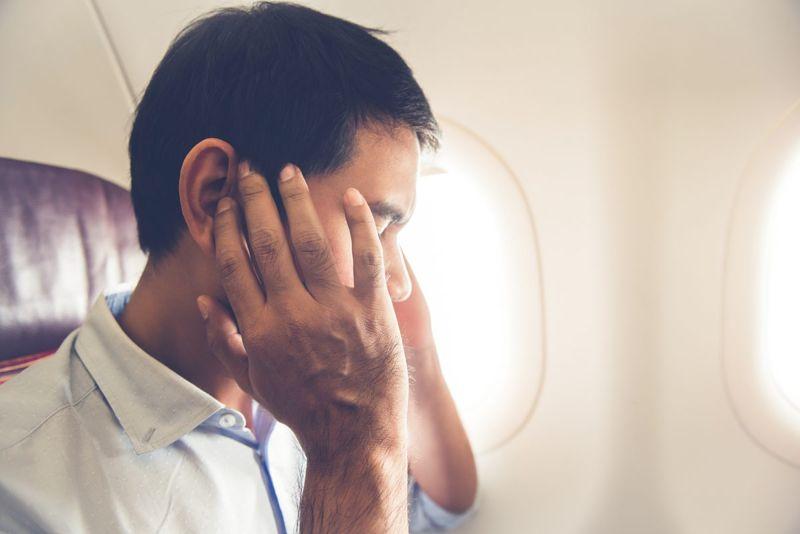 male passenger airplane ear