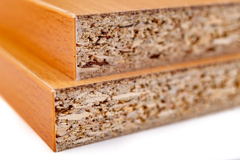 Stacked chipboard with veneer. Material for the construction of furniture in the carpentry shop. Workplace workshop.