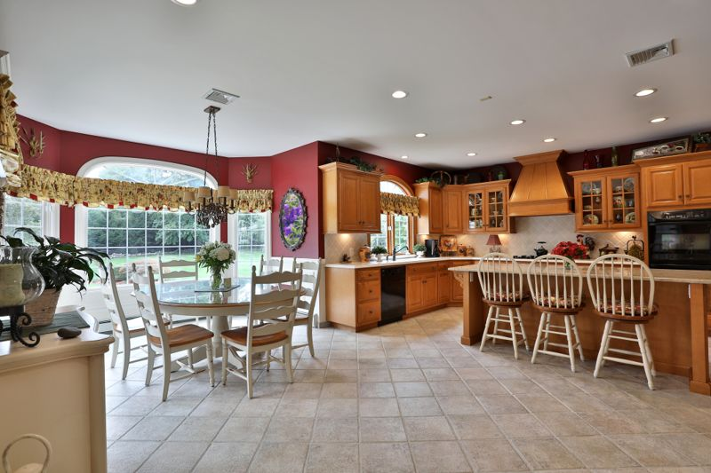 Luxurious spacious kitchen in a beautiful house looking toward spacious back yard