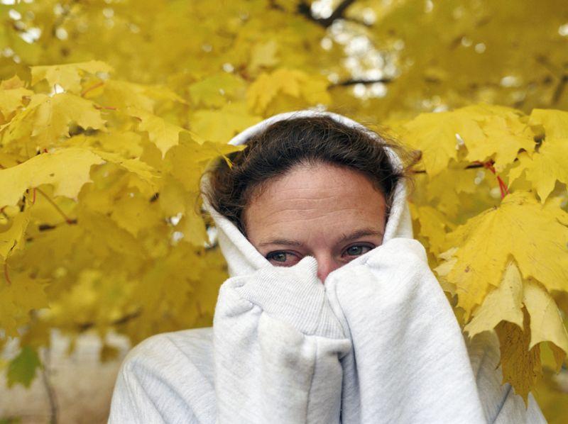 Woman wearing hooded sweatshirt, closeup, autumn