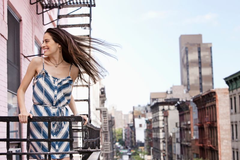 Portrait of young woman on fire escape