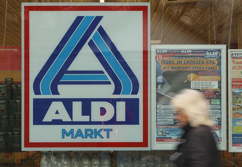 BERLIN - APRIL 07: A shopper leaves a branch of German discount supermarket chain Aldi on April 7, 2008 in Berlin, Germany. Germany's biggest service industry trade union ver.di has announced it will take Aldi to court over allegations that Aldi was paying Wilhelm Schelsky, a member of the AUB works council organization and instructor of Aldi works council members. Ver.di claims such payments are illegal and are a way for Aldi to influence its works councils. The works councils system in Germany offer employees influence on a company's managerial decisions.