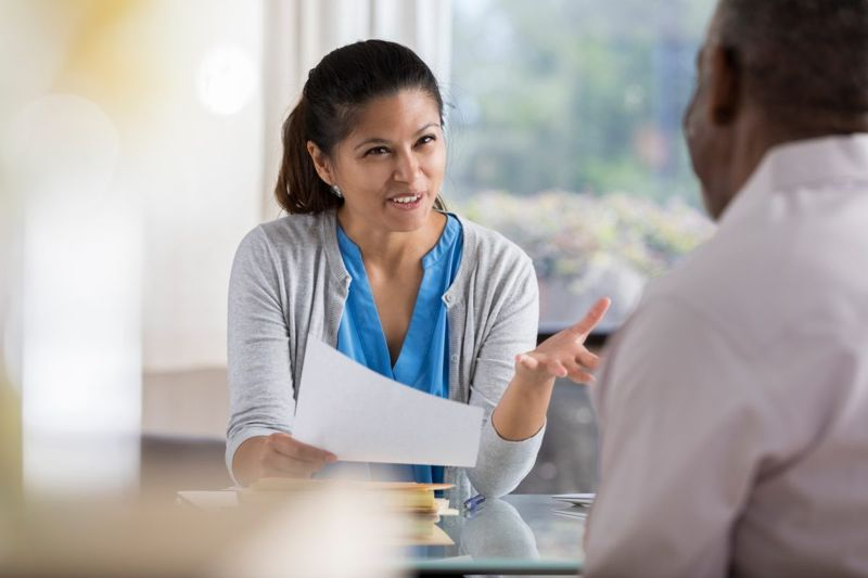therapist speaking with client