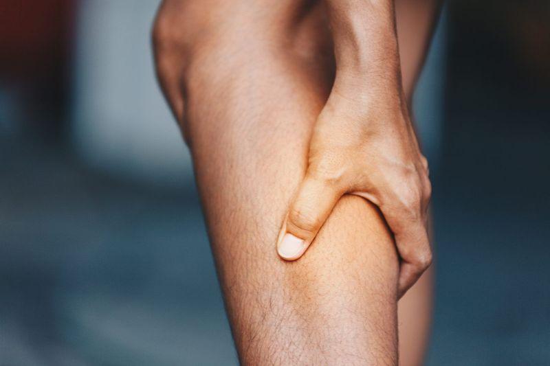 numbness cramping legs symptoms scoliosis