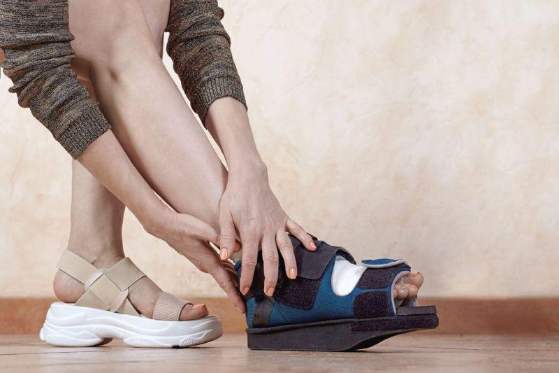 woman foot cast brace