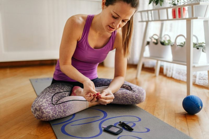 Fit woman using glucose meter