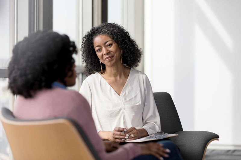 woman talks with therapist