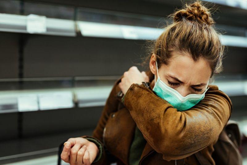 woman sneeze mask elbow