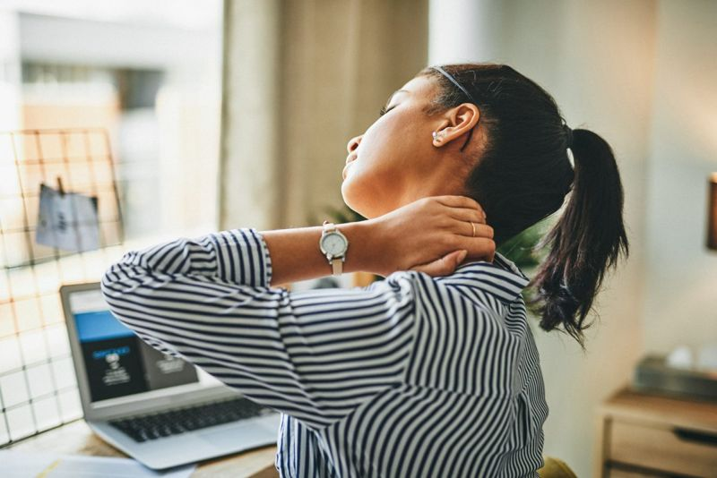 a woman stretching her neck