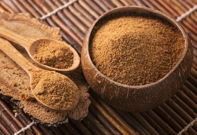 Coconut sugar in a coconut husk.