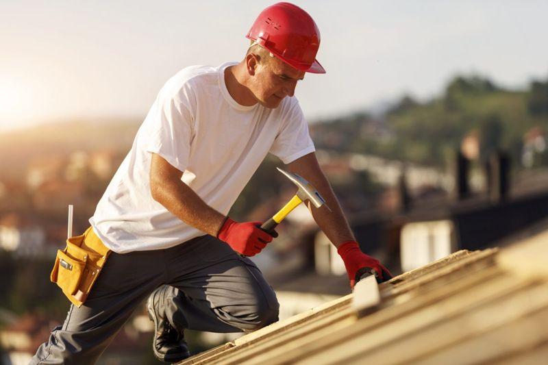 man wearing gloves hammer