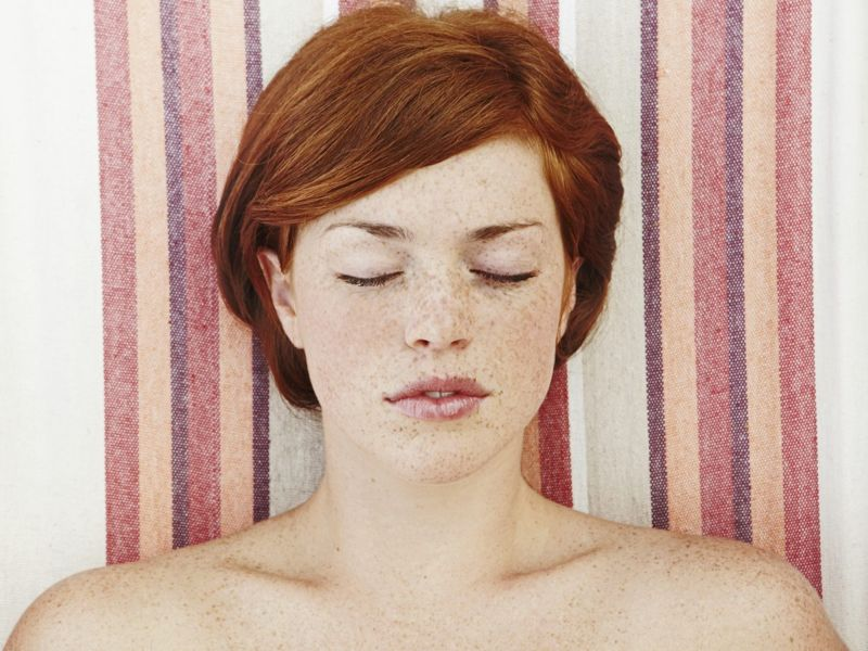 a woman with freckles on a towel