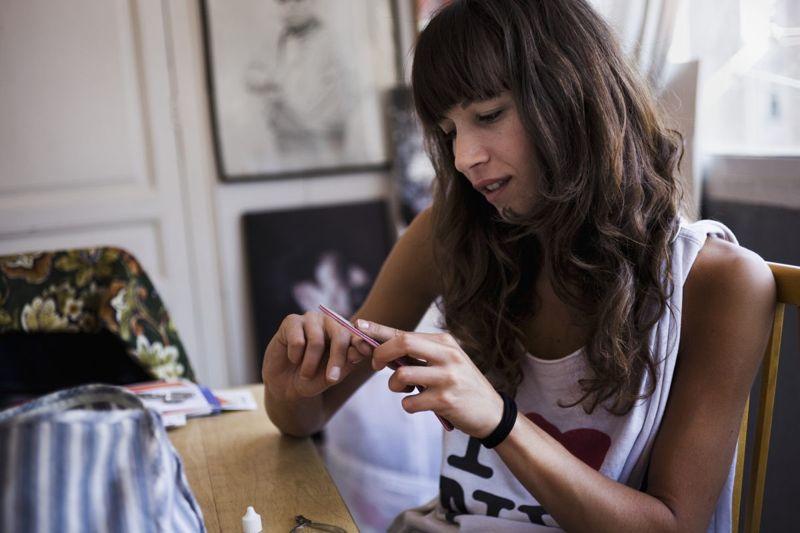 woman filing nails