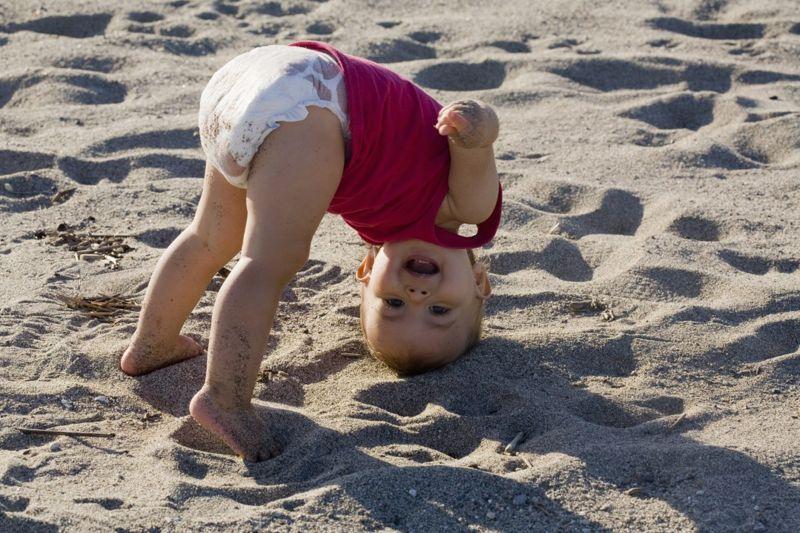 Baby playing at beach