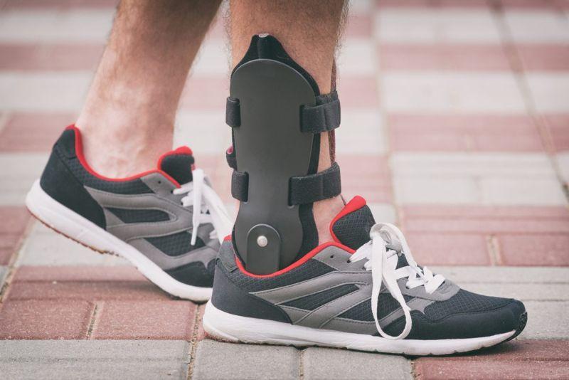 a person wearing a foot brace
