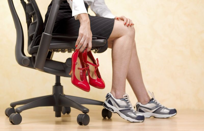 woman trades heels for running shoes